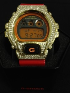 The Hulkamania of Watches. Red and Gold Iced Out G-Shock watch.