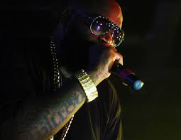 Rick Ross Treats Models To WingStop While On Tour